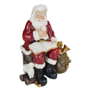 Babbo Natale seduto che legge